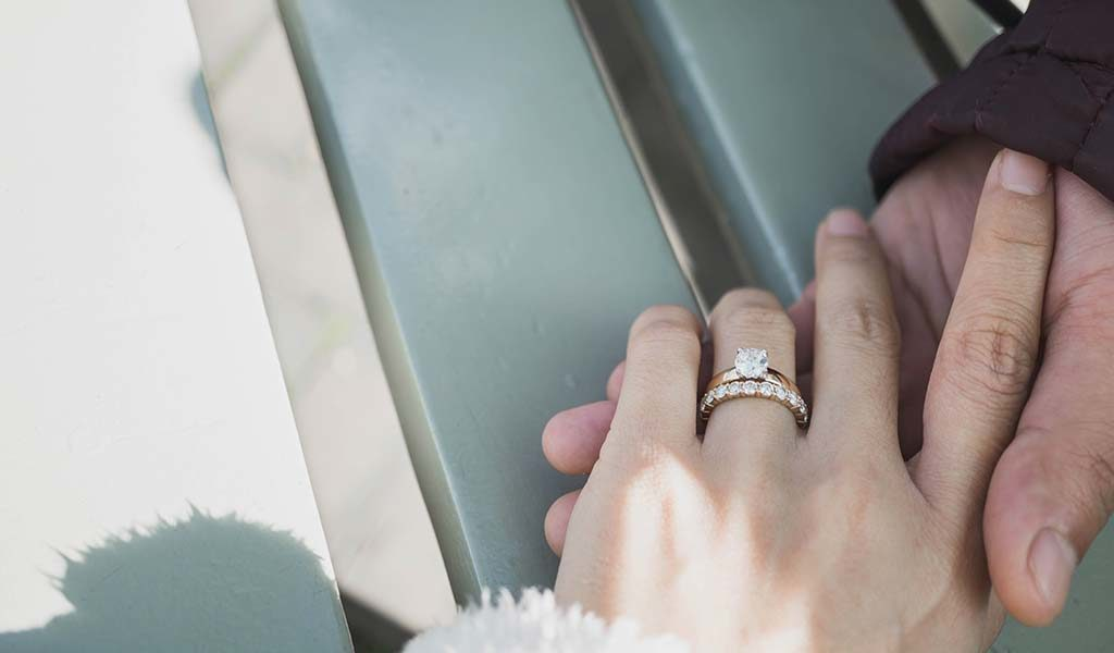 female hand with eternity ring