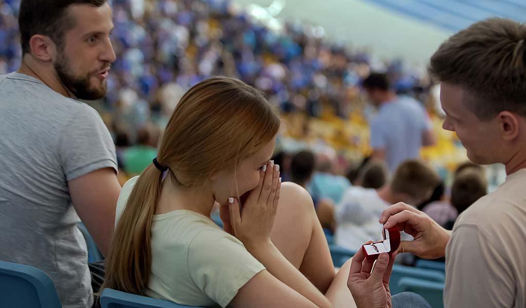 proposal in football stadium